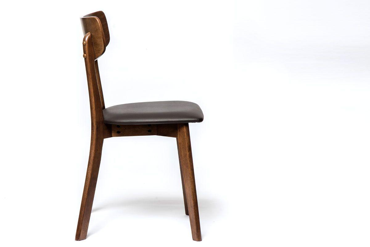 Filligraner Holzstuhl mit Kunstleder Sitzkissen